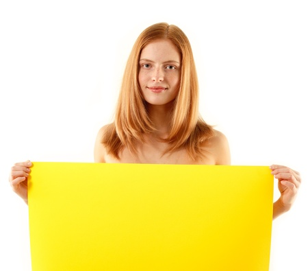 woman holding blank yellow banner isolated on white background photo
