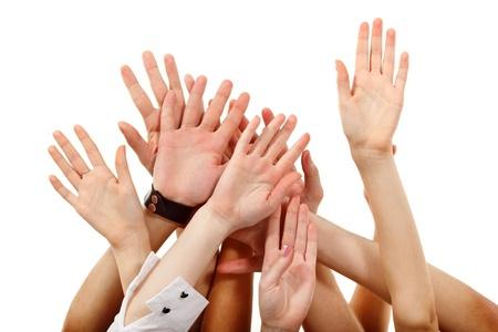 las manos en alto grupo de personas aisladas en blanco backround Foto de archivo