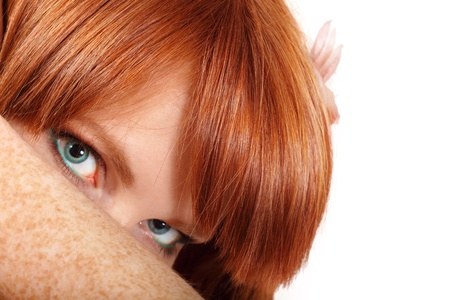 face teen girl beautiful freckles redheaded closeup isolated on white background photo