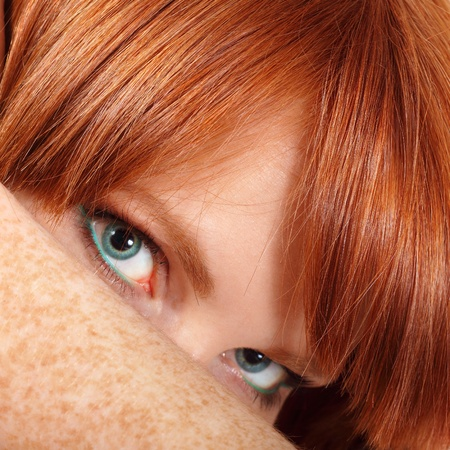freckles: face teen girl beautiful freckles redheaded closeup isolated on white background