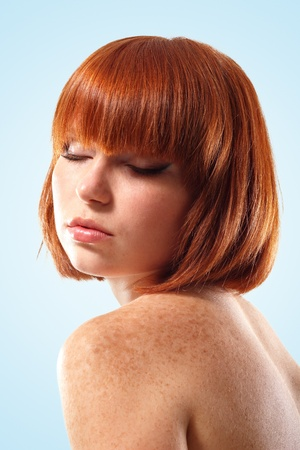 freckles: woman beautiful young make-up isolated on blue background