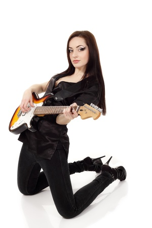 woman sexy beautiful musician playing guitar electric isolated on white background photo