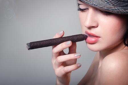 sexy smoking beautiful woman cigar closeup studio shot Stock Photo - 10510896
