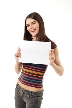 one sheet: teen girl cheerful holding blank white paper closeup isolated on white background Stock Photo