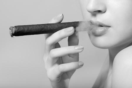 sexy smoking beautiful woman cigar closeup studio shot photo