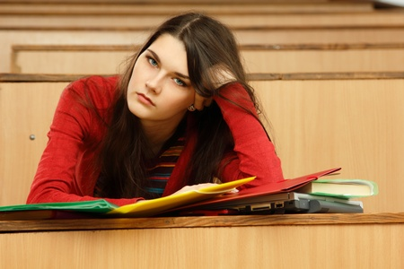 student teen girl beautifyl tired in empty classroom university  photo