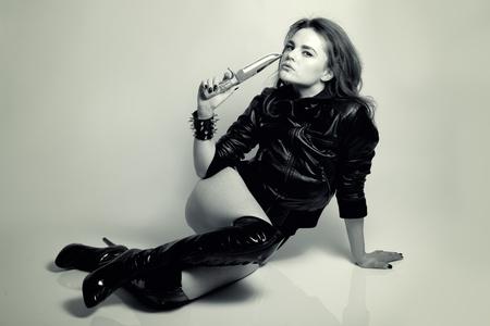 sexy beautiful woman predator with knife studio shot photo