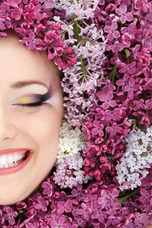 purple lilac: woman beautiful face with flower lilac frame Stock Photo