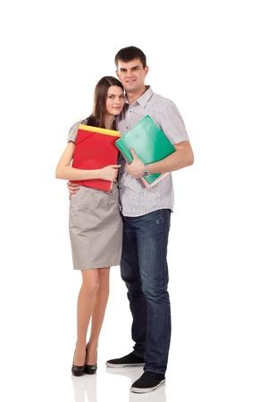 pareja de adolescentes: los estudiantes del grupo par feliz aisladas sobre fondo blanco Foto de archivo