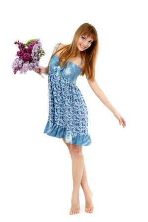 barefoot teens: teen girl beautiful fresh with spring bunch flower lilac dancing barefoot isolated on white background