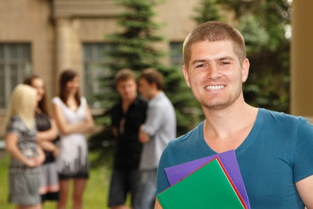 uni: student handsome cheerful outdoor portrait Stock Photo
