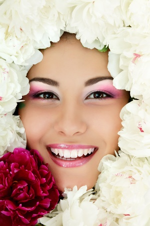 woman beauty face with flower peony frame isolated on white background photo