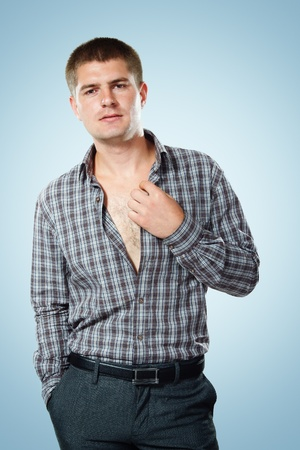 checked shirt: man young handsome over blue background