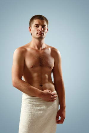 man young handsome athlete with bath towel over blue background photo