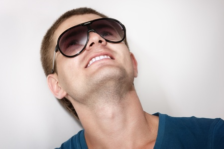 man young handsome athlete with sunglasses and blue t-shirt photo