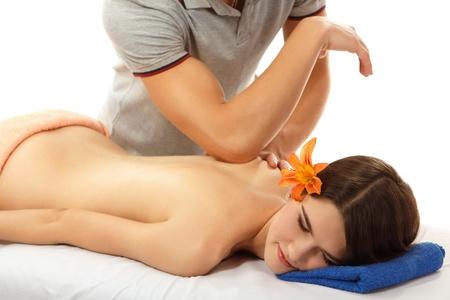 codo: una mujer joven y bella masaje en la espalda alegre aislado sobre fondo blanco Foto de archivo