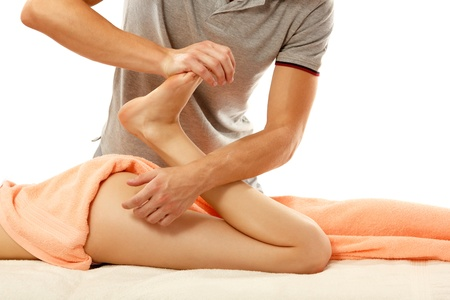 breech: masseur makes anticellulite massage young woman isolated on white background
