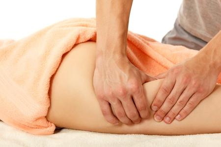 homme massage: masseur fait de la femme massage anticellulite jeune isol� sur fond blanc