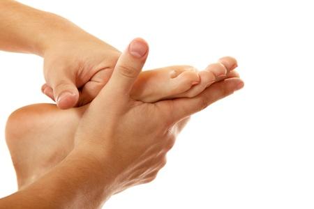 reflexology: massage foot female close-up isolated on white background Stock Photo
