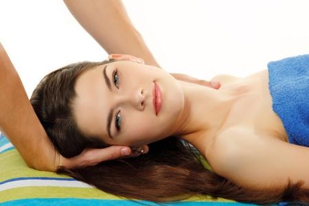 eye massage: massage woman young beautiful cheerful isolated Stock Photo