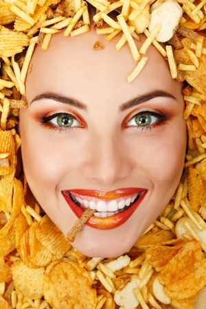 fastfood: woman beauty face with unhealth eating fast food potato chips rusk frame