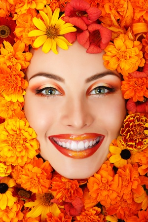 sexiness: woman beauty face with orange flowers frame  Stock Photo