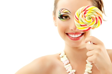 woman laughing with candy and beautiful make-up young attractive isolated on white background