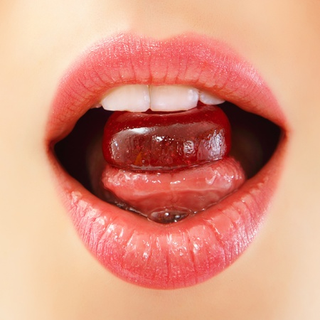 sucking: woman sucking cute sweet candy closeup lips teeth tongue Stock Photo