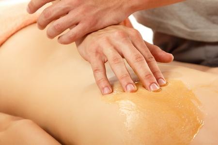 back massage: massage honey woman young Stock Photo