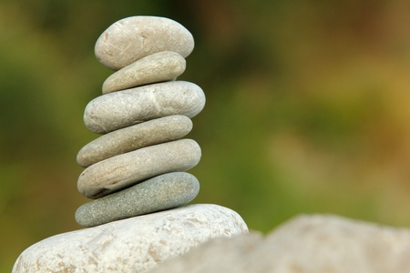 balanced stones over green nature background Stock Photo - 12509820
