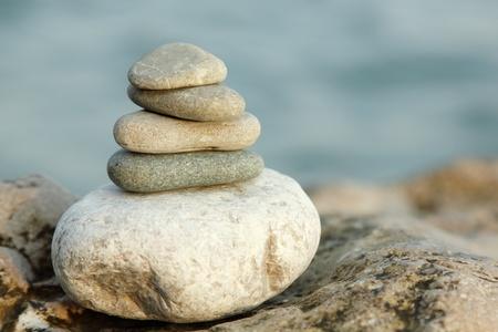 balanced stones over sea nature background photo