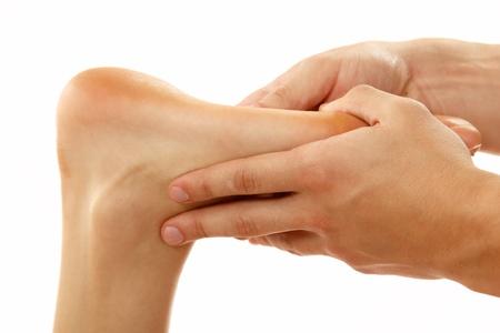 massage foot female close-up isolated on white background Stock Photo - 12809960