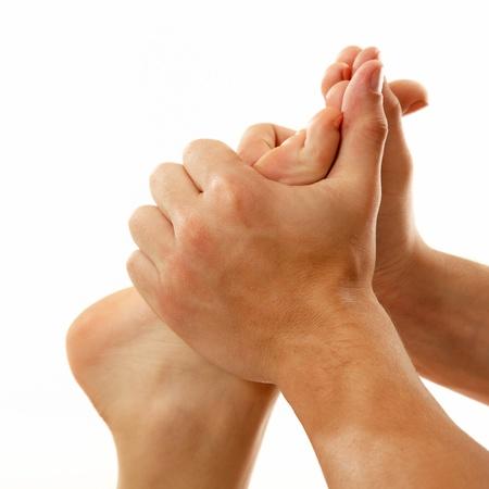 hands massage: massage foot female close-up isolated on white background Stock Photo