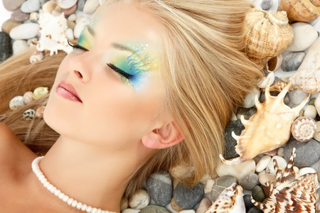 teenager girl mermaid beautiful make-up photo