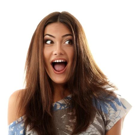 tiener meisje aantrekkelijke verrast merk gezichten op witte achtergrond