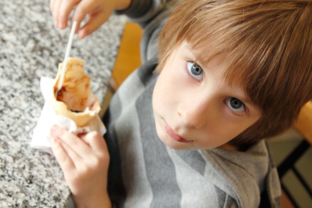 boy child cute eating ice cream in cafe Stock Photo - 13367158