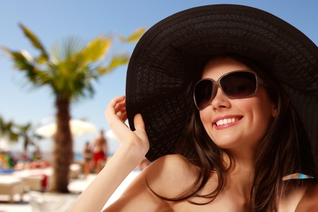 brunets: summer beach teen girl cheerful in panama and sunglasses enjoying