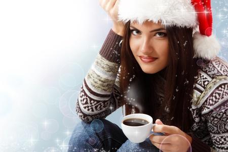 christmas teen girl attractive drinking coffee photo
