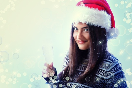 christmas woman young beautiful smiling with champagne and santa's hat  Stock Photo - 13404368