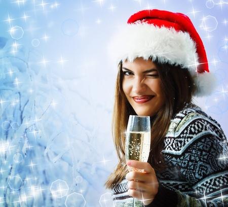 woman christmas young beautiful smiling with santas hat  photo