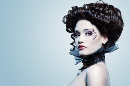 vampire: woman beautiful halloween vampire baroque aristocrat over blue background