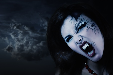 female vampire: evil vampire woman beautiful halloween over night background