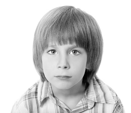 blond boy: boy troubled isolated on white background Stock Photo