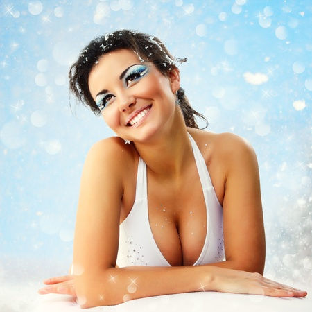 woman christmas young beautiful sexy smiling over nature background photo