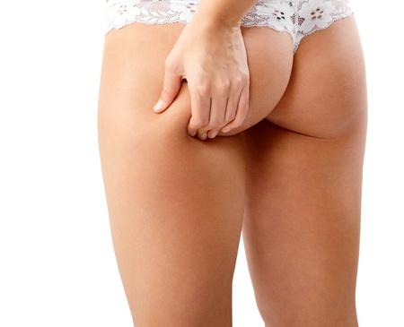 nalga: nalgas femeninas de cerca aisladas sobre fondo blanco Foto de archivo