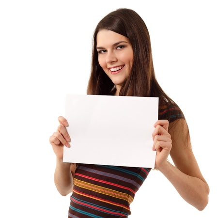 teen girl cheerful holding blank white paper closeup isolated on white background photo
