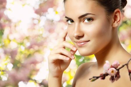 teen girl beautiful cheerful enjoying over spring Japanese cherry tree background photo