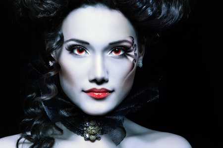 woman beautiful halloween vampire baroque aristocrat over black background photo