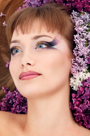 woman beautiful face with flower lilac frame photo