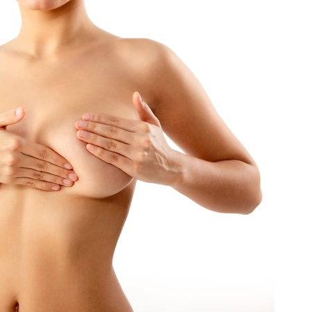 woman examining breast mastopathy or cancer isolated Stock Photo - 13786149